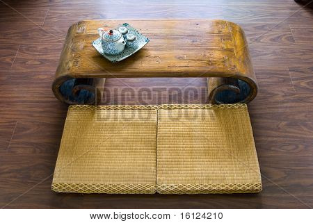Traditional Japanese Straw Mattress, Table And Tea Pot.