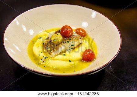 Murmansk Roasted Halibut With Mashed Potatoes And Tomato Lying O