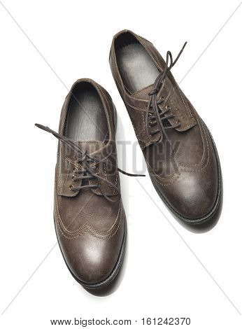 Top View of Men's Leather Shoes on White Background