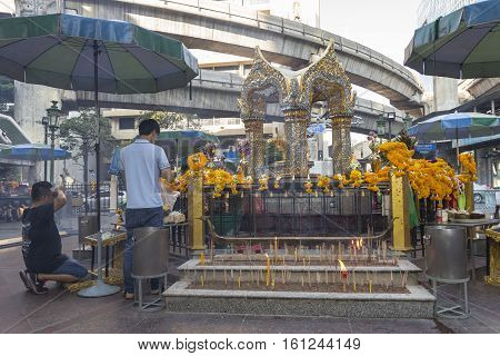 BANGKOKTHAILAND - NOV 26 : tourist worship to Erawan shrine at Ratchaprasong Junction on november 26 2016 Thailand. Erawan shrine is famously sacred place in bangkok