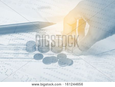 Double exposure hand with stack of coins and utility bill with calculator and account banking for finance, Money and finance concept