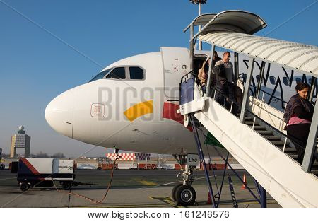 Passengers Unboard Wizzair Airplane. Wizzair Is A Low-cost Carrier Based In Hungary