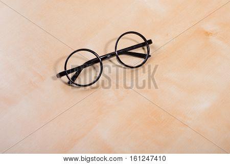 round frame for eyeglasses black frames folded on the table