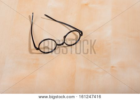 round frame for eyeglasses black lies open on the table
