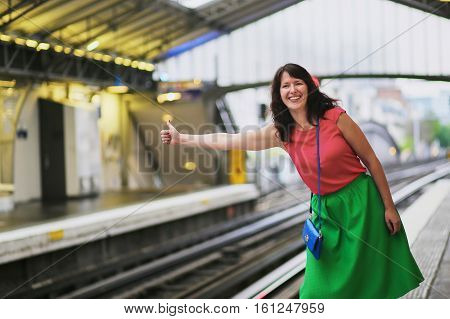 Cheerful Young Woman In Parisian Underground