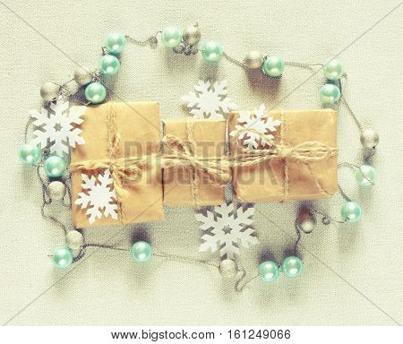 Three Christmas gift box beads garland snowflakes on canvas tablecloth retro style