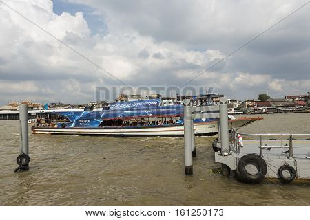 BANGKOK THAILAND - NOV 19 : ferryboat with tourist in chao phraya river near Wat Arun temple on november 19 2016 thailand. chao phraya river is famous sightseeing route of Bangkok