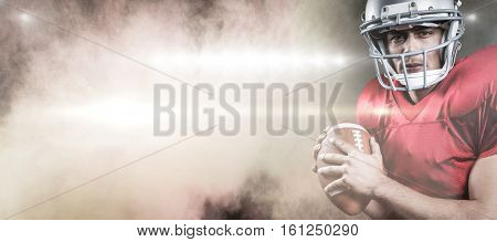 3D Portrait of serious American football player holding ball against splashing of color powder