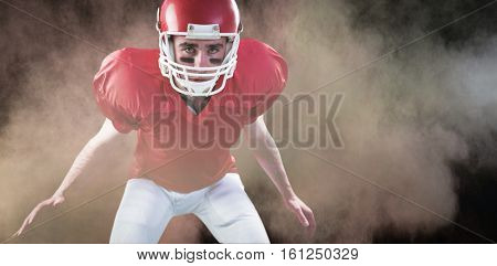 3D A serious american football player taking his helmet looking at camera against splashing of color powder