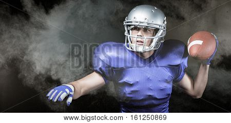 Serious American football player throwing ball against digitally generated image of color powder