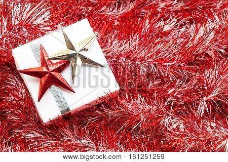 Christmas Gift Box And Decoration On Red Fir Twigs