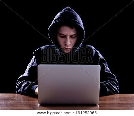 Computer Hacker Stealing Data From Laptop
