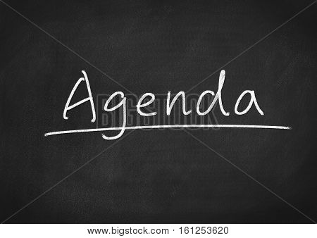 Agenda concept word text on blackboard background