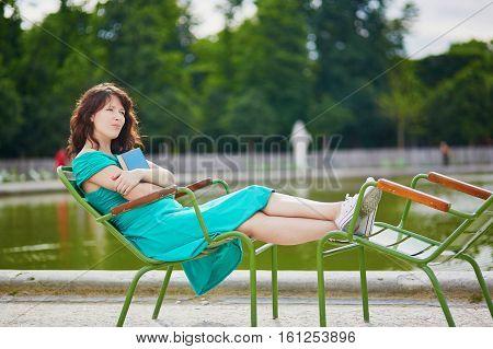 Beautiful Young Woman Relaxing In Parisian Tuileries Park