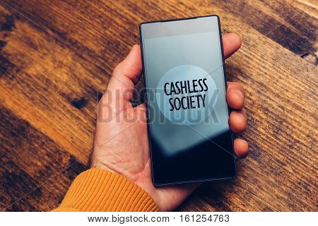 Cashless society concept man using smartphone for electronic payment and online business transactions