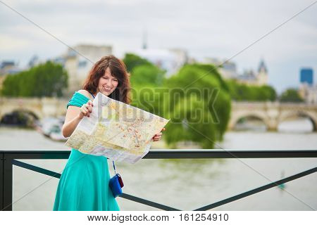 Young Woman With Map In Paris