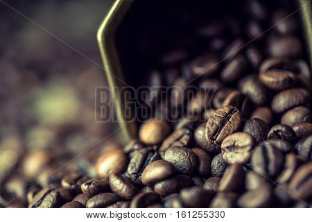 Coffee. Coffee beans.Spilled coffee beans. Toned photo