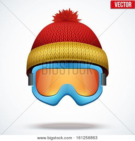Knitted woolen red cap with snow goggles. Winter seasonal sport hat. Vector illustration isolated on white background.