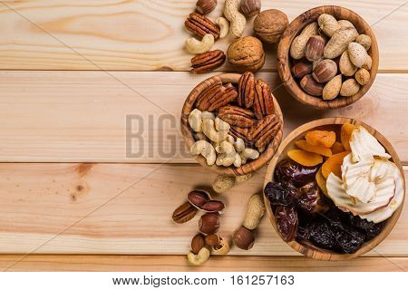 Selection of dried fruits and nuts as symbols of Tu Bishvat, copy space