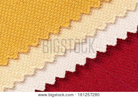Composition of colored diagonal stripes of serrated cotton fabric place for text