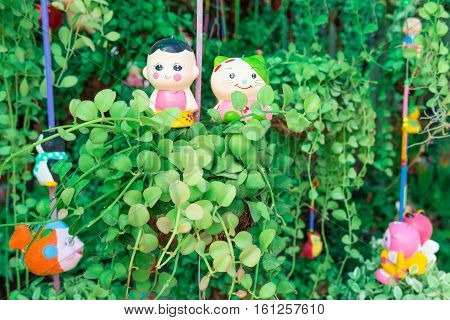 Dave and dolls hanging in the garden.