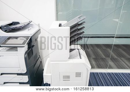 modern printer machine with many output feeder in office