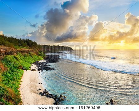 White sandy beach at sunrise. Mauritius. Panorama