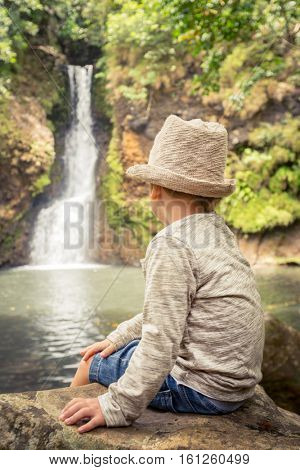 Child looking Chamouze waterfall. Mauritius island