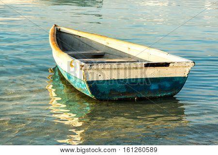 Old fishing boat at sunset. Mauritius