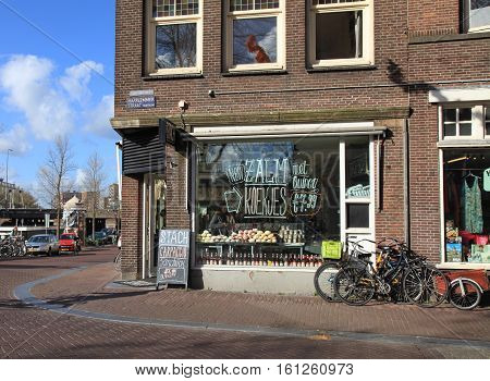 AMSTERDAM, NETHERLANDS - MAY 3, 2016: Cityview with modern Stach cafe window on Haarlem street in Amsterdam, Netherlands.