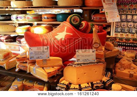 AMSTERDAM, NETHERLANDS - MAY 3, 2016: Display of traditional Dutch cheese like Edam and Gouda cheese on a table at local cheese shop, Amsterdam, the Netherlands. Selective focus