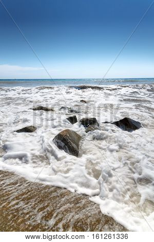 stones in water wave black sea / bright summer photo Alushta Crimea