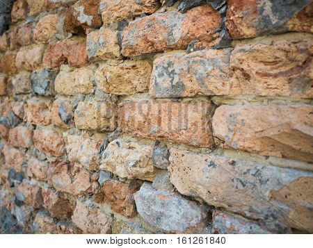 Close up on an old brick wall texture, focus on the middle of the wall. Background of the brickwall pattern close up.