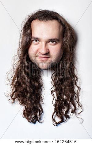 Funny men's head hair with long curly hair. Close-up on a white background head.