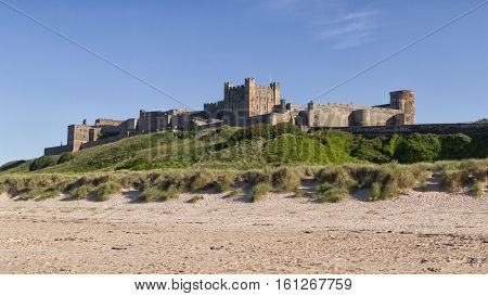 Bamburgh Castle, on the coast at Bamburgh, Northumberland, England, is a Grade I listed building. This is a vieew from the coastle side.