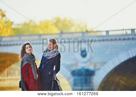 Two Young Girls Walking Together In Paris