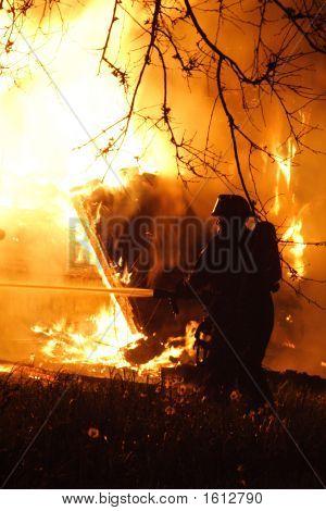 A Fireman Fighting A Fire
