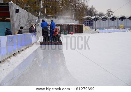Moscow ice rink in Sokolniki Park November 18, 2016, the machine prepares the surface for skating.