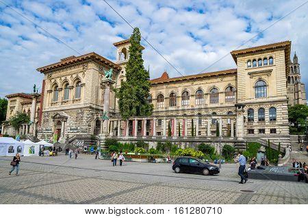 LAUSANNE SWITZERLAND - JUNE 9 2011: Everyday life on Place de la Riponne near Palais de Rumine in the center of Lausanne