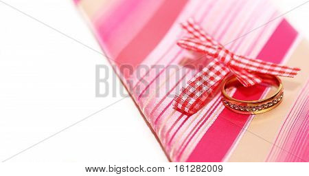 Two wedding rings on the tie and ribbon, pink color