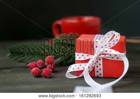 Gift Box Tied With A Red Ribbon , Fir Branches,