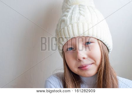 Portrait Of Young Beautiful Teen Girl In A Knitted Hat