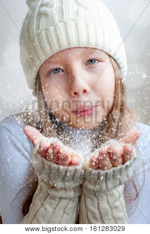 Happy Girl In Winter Clothes Blowing On Palms Winter Happiness And Carefree .