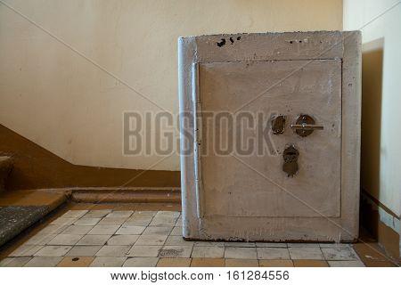 Vintage safety deposit box. Old fireproof cabinet in a corner.