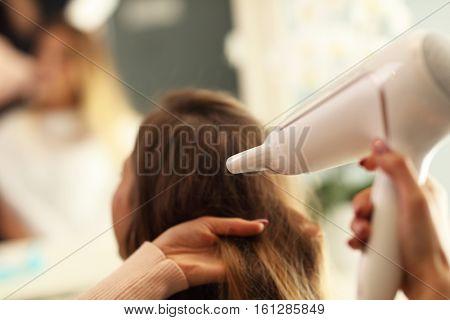 hairdresser holding hair dryer