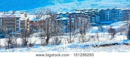 Bansko, Bulgaria - November 30, 2016: St. Ivan Rilski and Panorama hotel and snow mountains in bulgarian ski resort Bansko