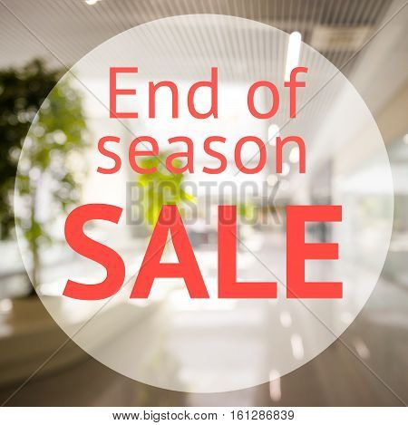 End of season sale sign over blurred store background. Design for shop and sale banners