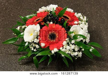 Flowers decoration with gerberas and with gerberas and white bells on gray background