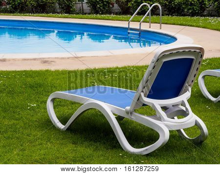 Poolside lounger by the hotel swimming pool at Portmeirion Wales
