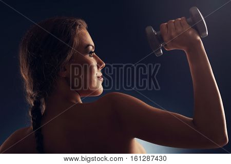 Picture of woman lifting dumbells